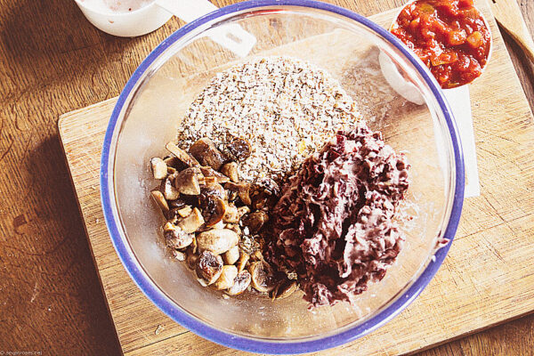 In a food processor, pulse the oats until you have mostly oat flour with some whole oats remaining, for texture. Transfer to the bowl. Put the black beans in the food processor and blend until mostly pureed with some whole beans remaining, also for texture. Transfer to the bowl.