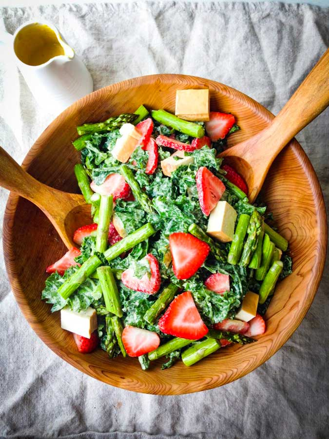 Smoked tofu, strawberry, and asparagus kale salad with creamy tahini dressing
