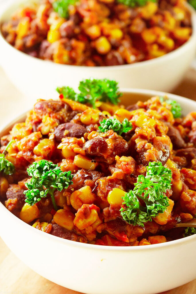 Craving a hearty dish? Try this 20-minute easy Vegan chili recipe made with pantry staples, you probably already have in your pantry! With a secret ingredient for added body and richness