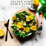 Summer salad with tofu feta, golden kiwis and edible flowers